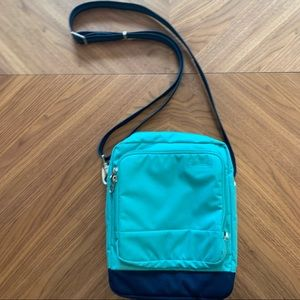 PacSafe blue turquoise travel pocket crossbody bag